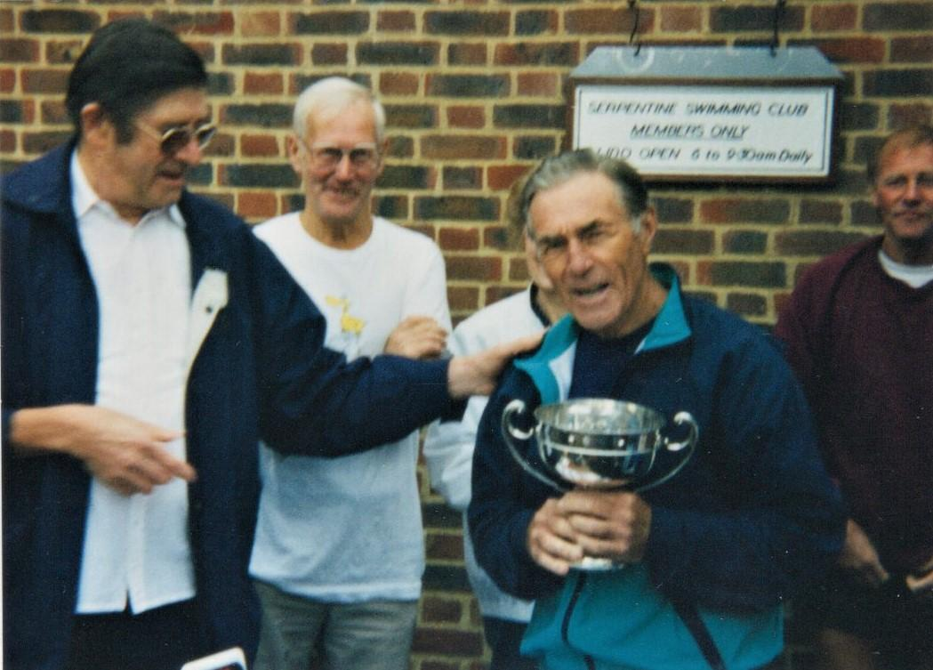 Two times club President (1974-1977 and 1998-2001)  Alan Lacy presented with the trophy, 1996