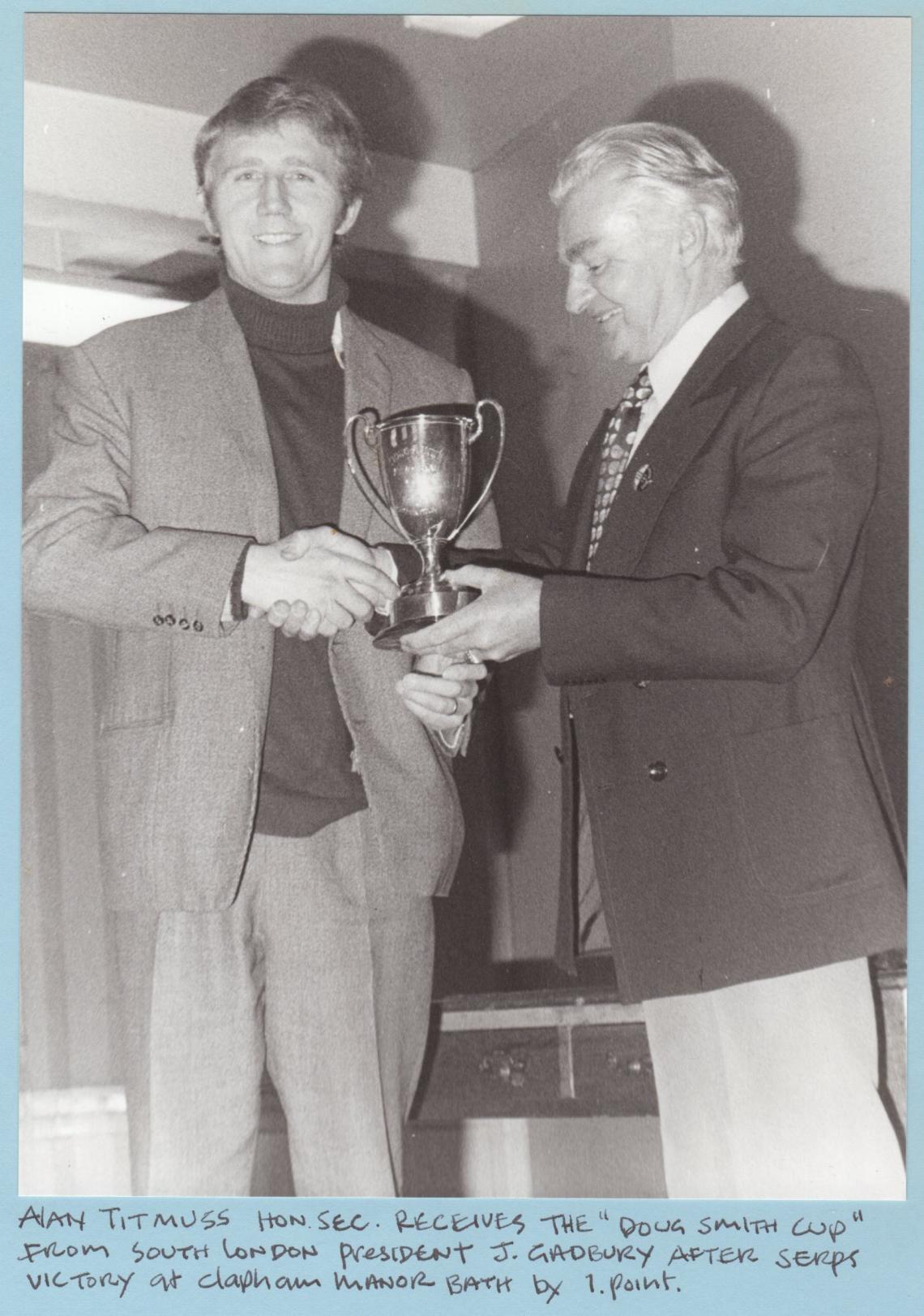 1977, SSC Hon. Sec. receives the cup from SLSC president J Gadbury