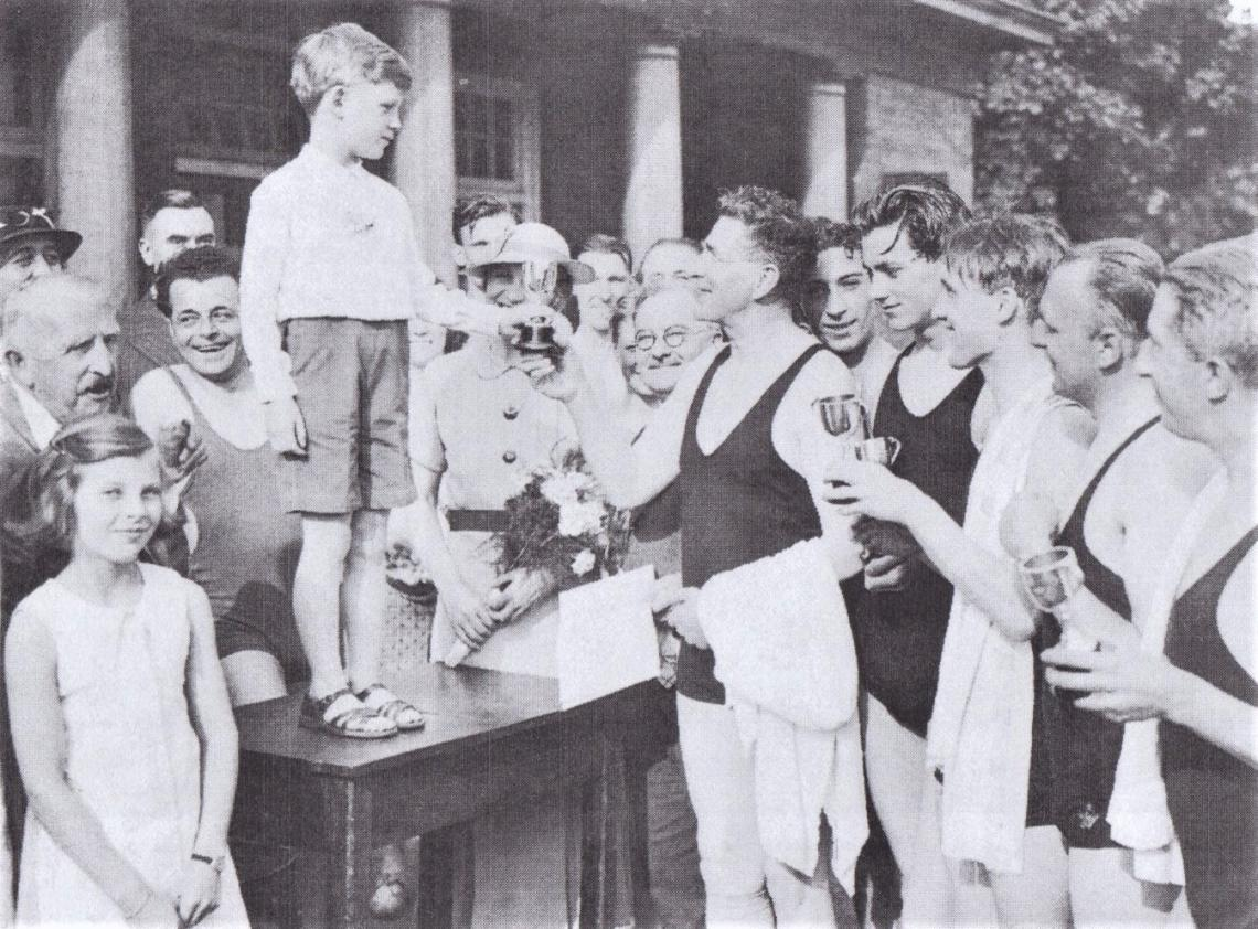 This photo from the mid 1930s shows son Gerald presenting trophies to the winning team.  The table is still in use by the club to this day (currently in storage)