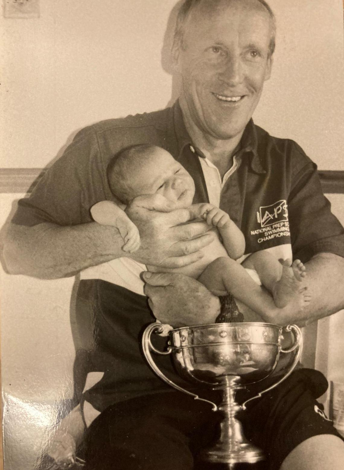 In 2004 Norman became a grandfather three days before his third Bridge to Bridge victory.  Three day old Isabelle neatly fitted into the trophy.