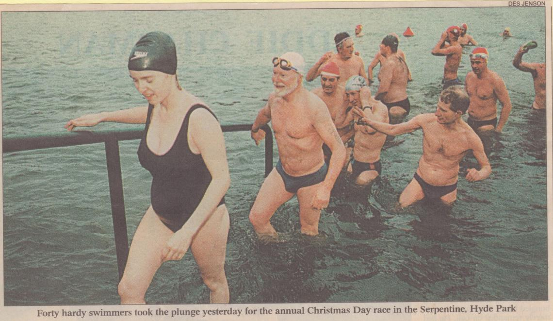 1997, and Mary leads Alan Nash out of the water at the finish of the race
