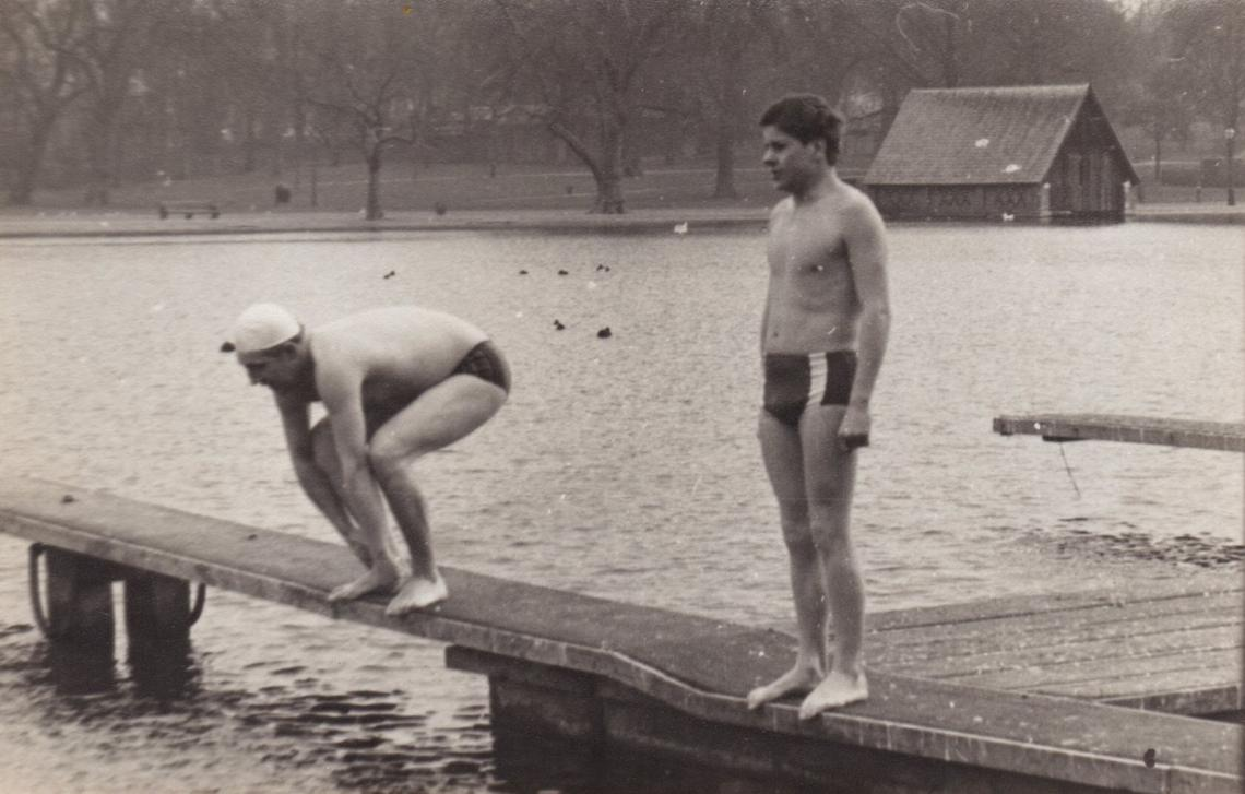 1968, 4 x 110 yard freestyle relay.  Tony waiting patiently for his team's final leg.  Alan Titmuss (rival team) prepares for a flyer.