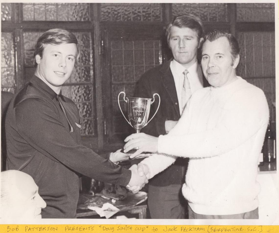 1971 Bob Patterson presents the cup to SSC president Jack Peckham.  Watched on by Alan Titmuss.