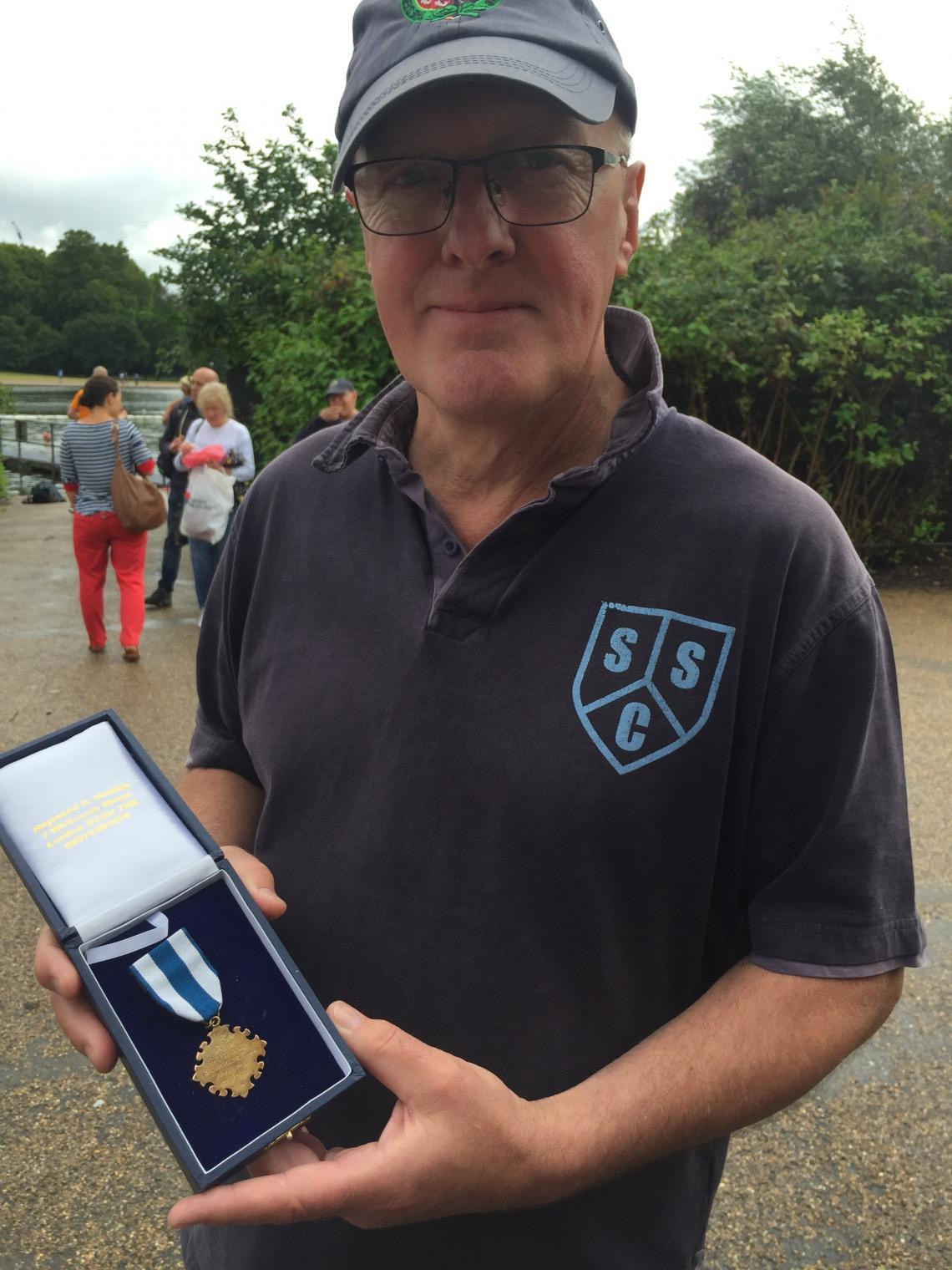 Bobby Baxter showing his grandfather's 1889 Christmas Day medal