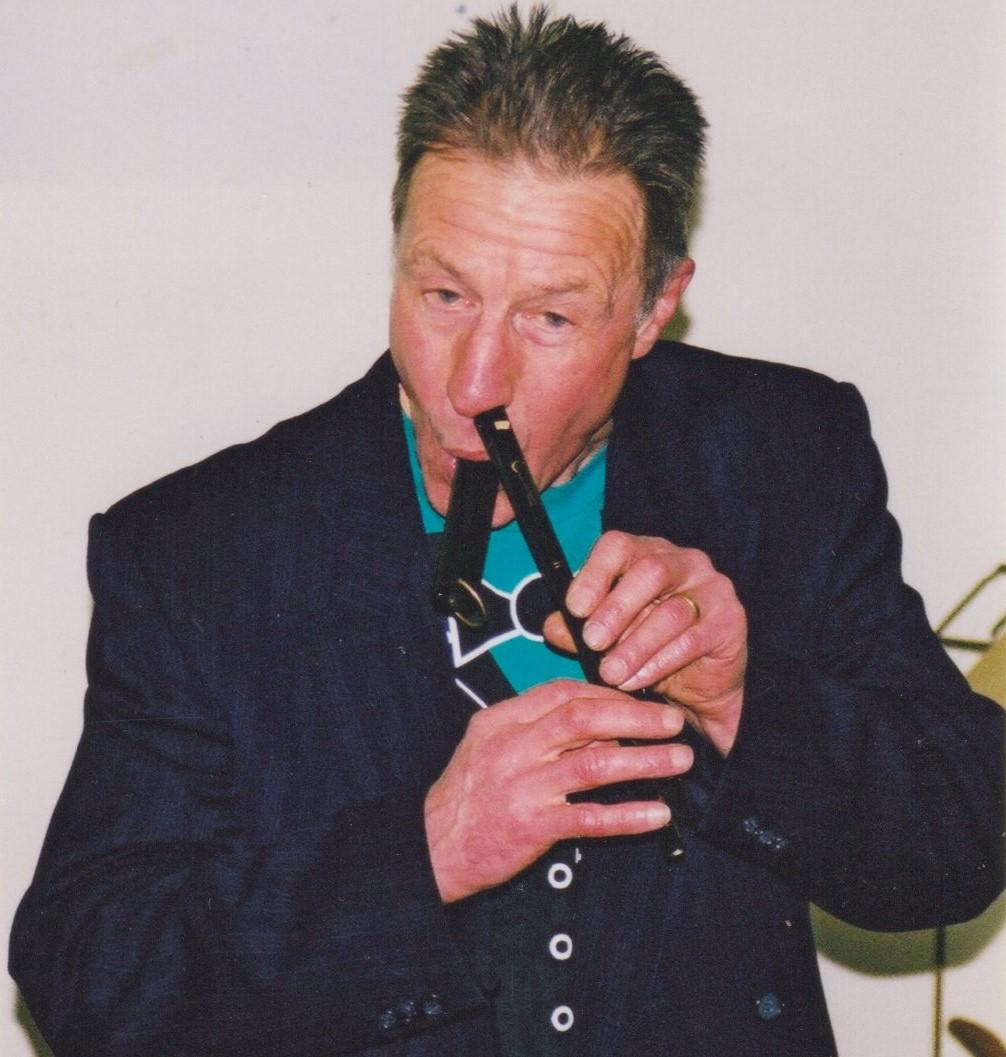 2002, multi-tasking.  Nose flute with duck quack whistle accompaniment.