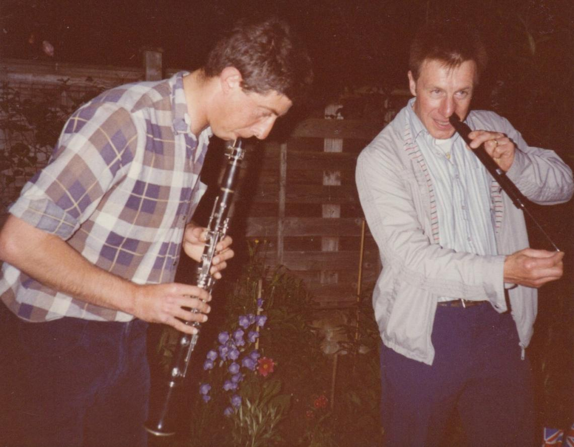 Dave on clarinet, accompanied by Bill Phipps on nose-flute at the 1985 summer barbeque in Alan Titmuss's back garden