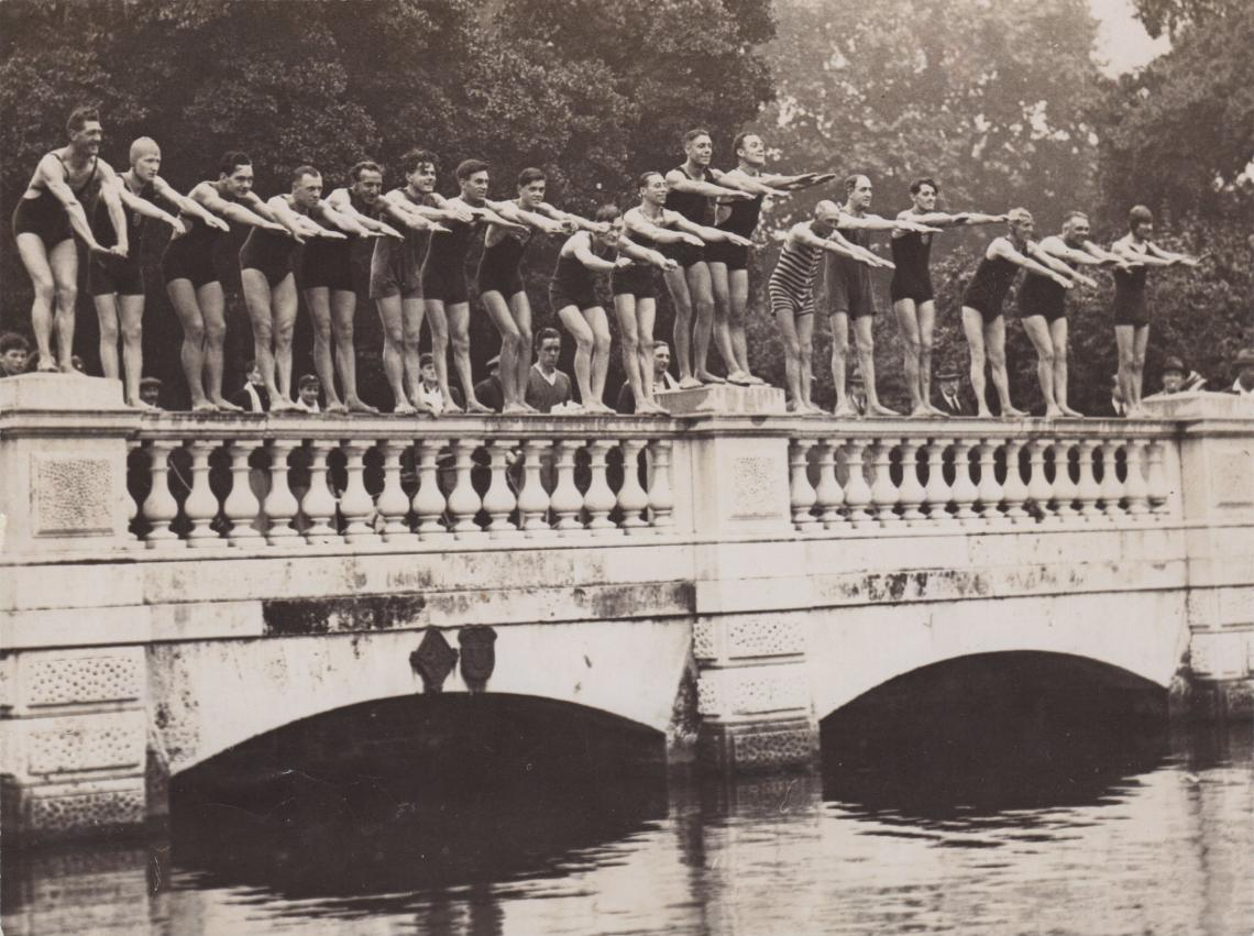 Club members posing for the camera on the Dell bridge, 1931